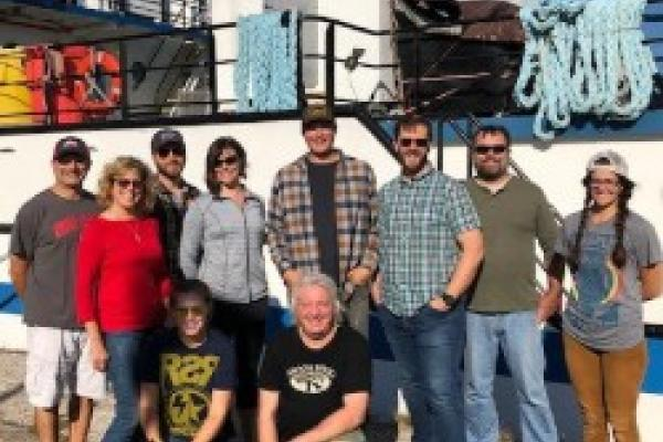 Group photo including Dr. Ludsin in front of the sampling vessel.