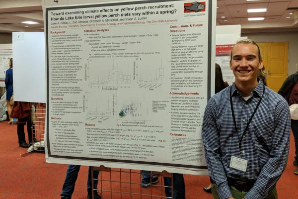 AEL undergraduate researcher Luke Bobay and his poster